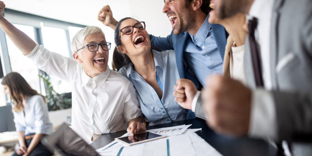 Business team celebrating a good job in the modern office